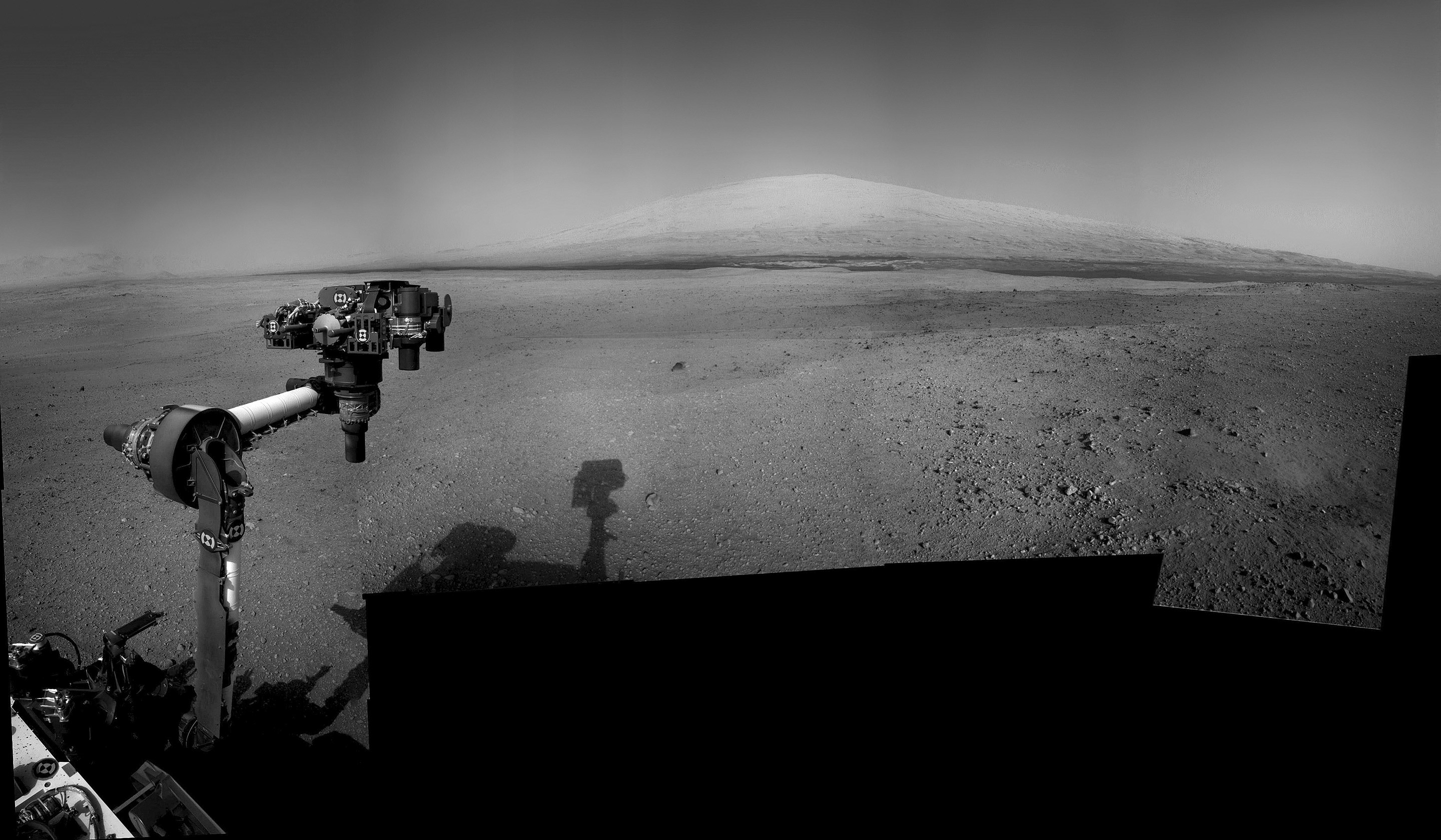 Curiosity Points the way to Mount Sharp. The rover deployed the robotic arm on Aug. 20 and aimed it directly at her ultimate Martian destination - the three mile high mountain named Mount Sharp. Credit: NASA/JPL-Caltech/Ken Kremer/Marco Di Lorenzo