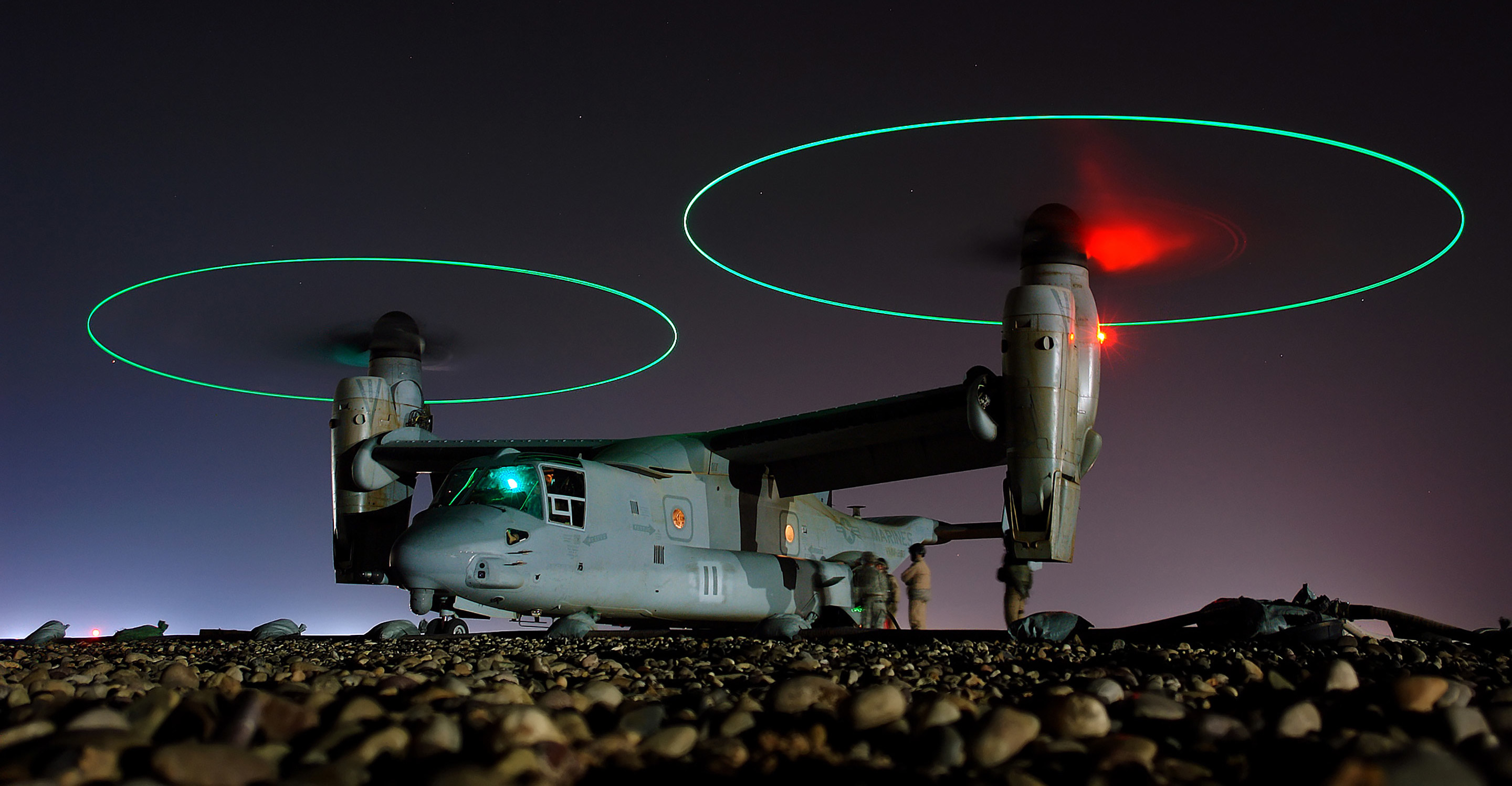 Crew members refuel an V-22 Osprey before a night mission in central Iraq.Photo: U.S Navy/Chief Petty Officer Joe Kane