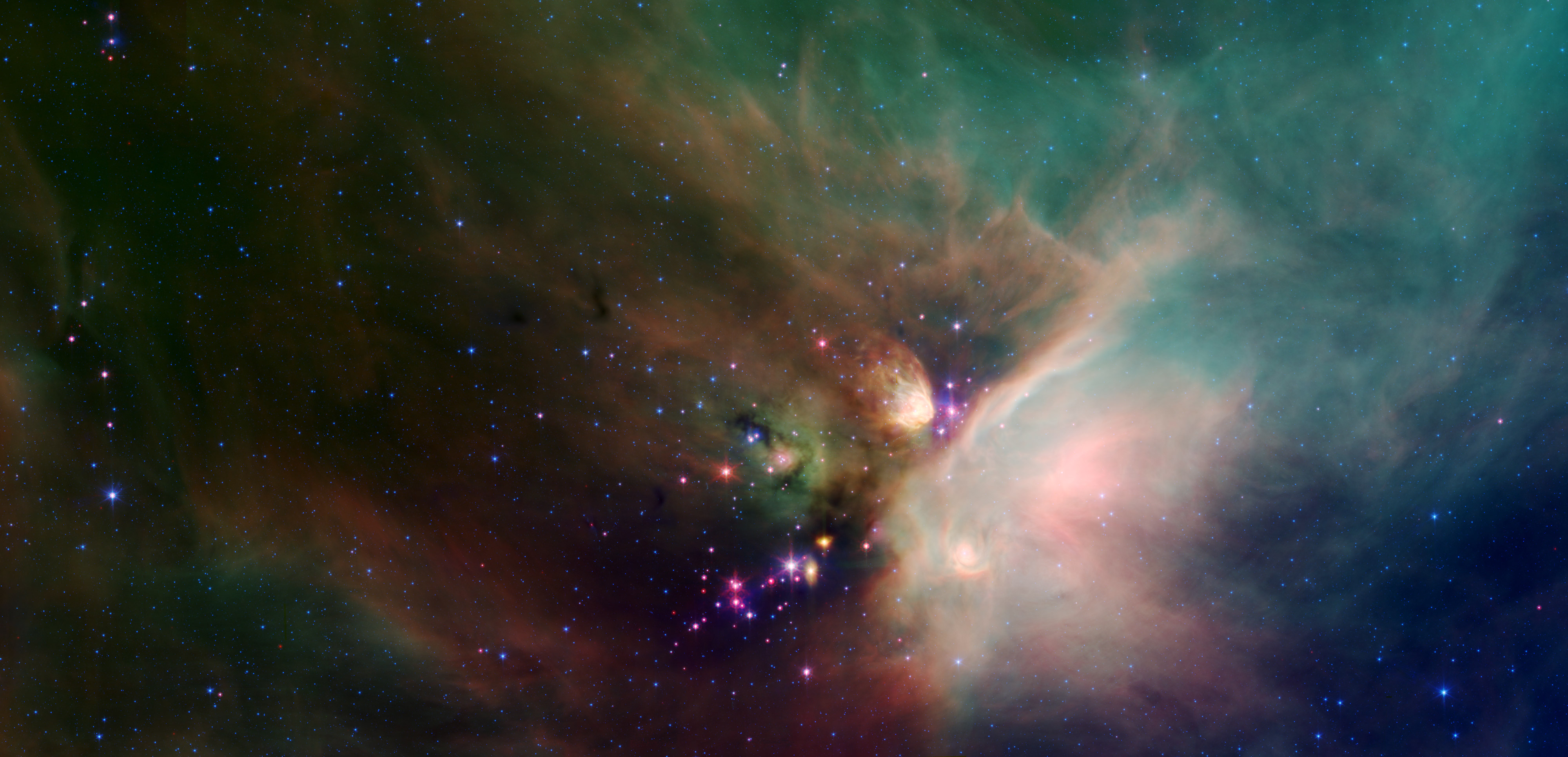 Young Stars Cradled in Dust: Newborn stars peek out from beneath their natal blanket of dust in this dynamic image of the Rho Ophiuchi dark cloud from Spitzer. Credit: NASA/JPL-Caltech/Harvard-Smithsonian CfA