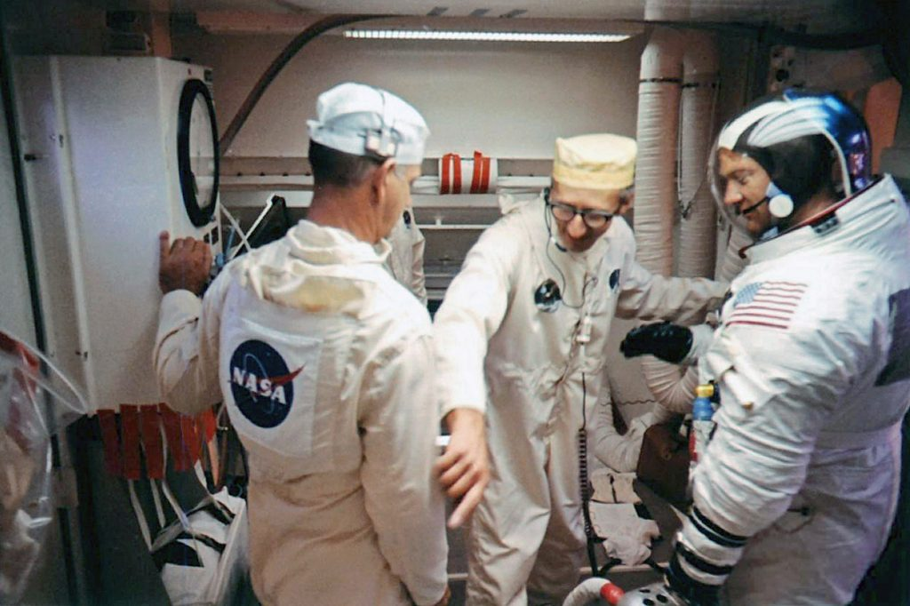 Edwin 'Buzz' Aldrin and Pad Leader Guenter Wendt in the White Room leading into the CM atop the Saturn V rocket at the launch pad on July 16, 1969.