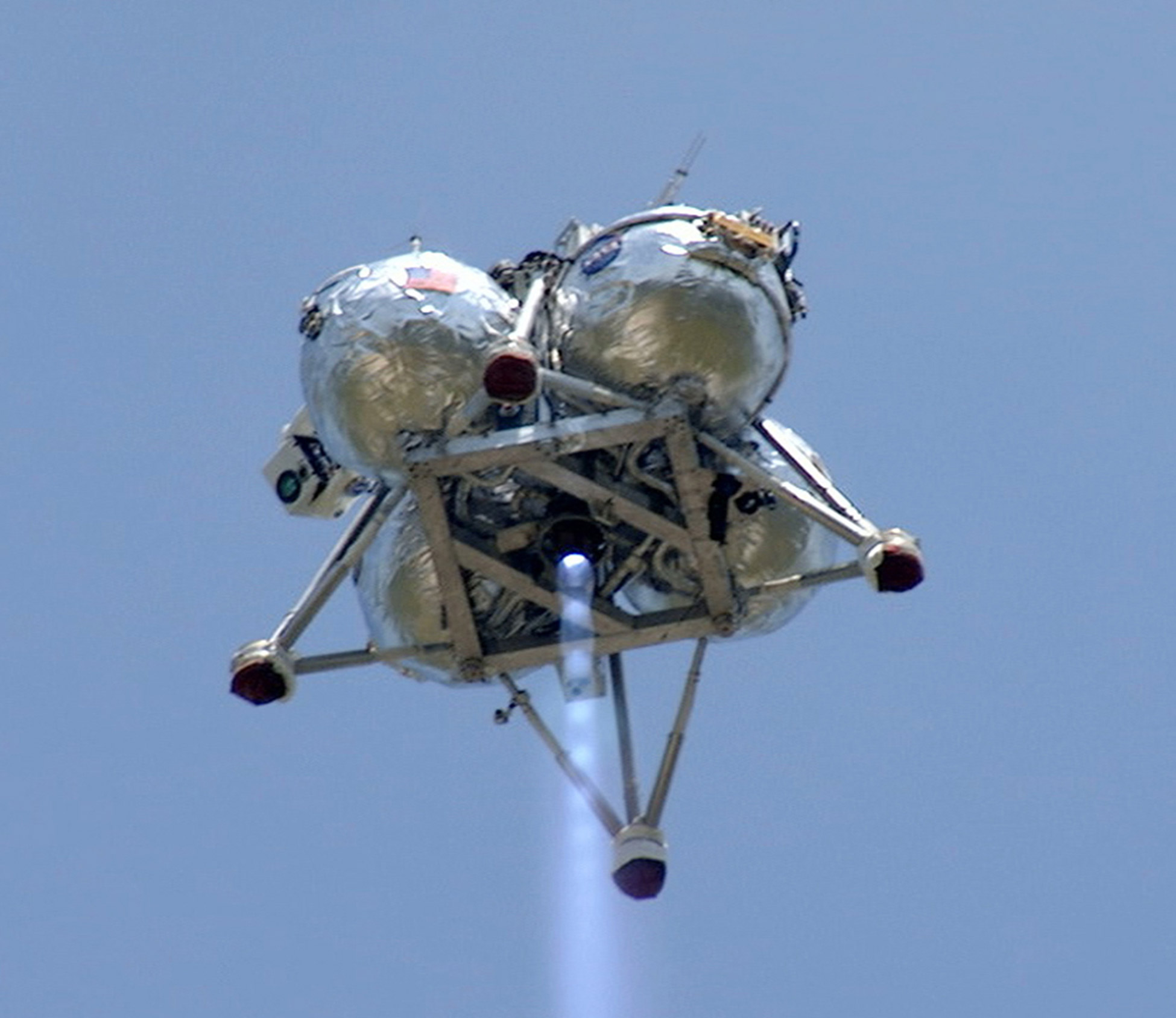NASA's Project Morpheus prototype lander performs a free-flight test from a launch pad at the north end of the Shuttle Landing Facility at NASA's Kennedy Space Center in Florida. Credit: NASA/Mike Chambers and Chris Chamberland