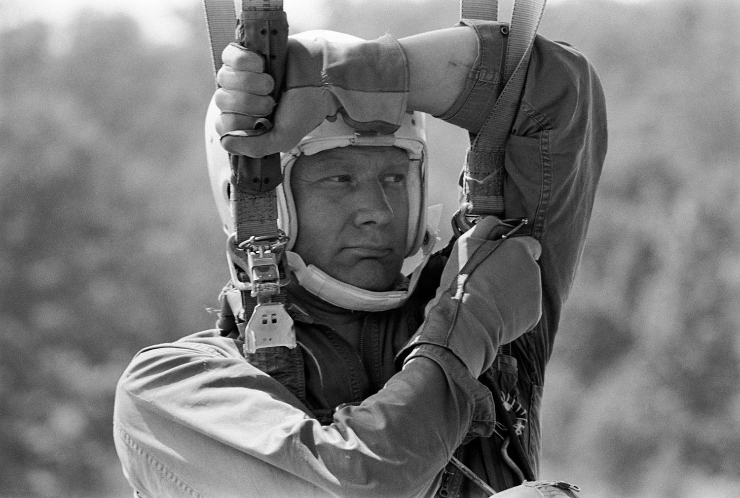 Hanging from a parachute harness, Buzz Aldrin undergoes aircraft ejection training at Perrin Air Force Base near Sherman, Texas during May of 1968. Credit: NASA via Retro Space Images