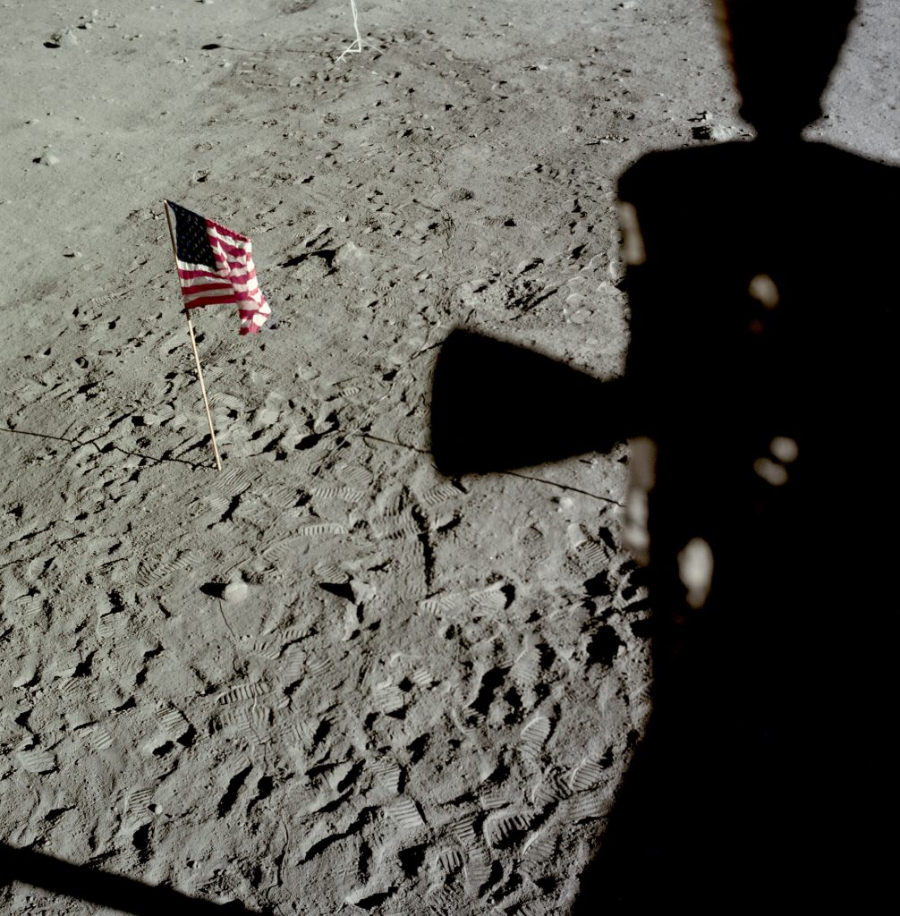 The American flag left on the Moon is viewed from the Eagle LM . The flag was blown over by the exhaust from the ascent engine during the return to orbit.