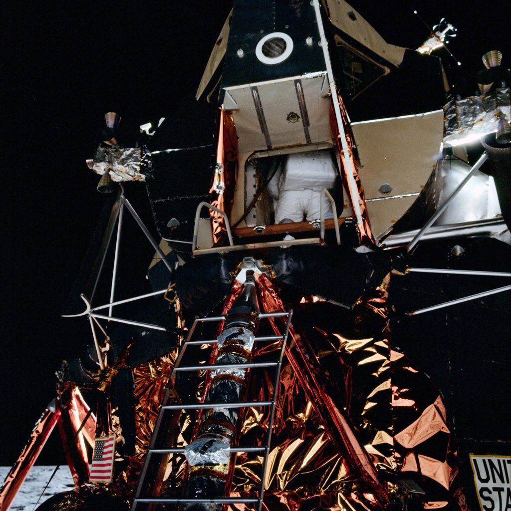 Edwin 'Buzz' Aldrin, lunar module pilot, egressing the lunar module during the extravehicular activity on the lunar surface.