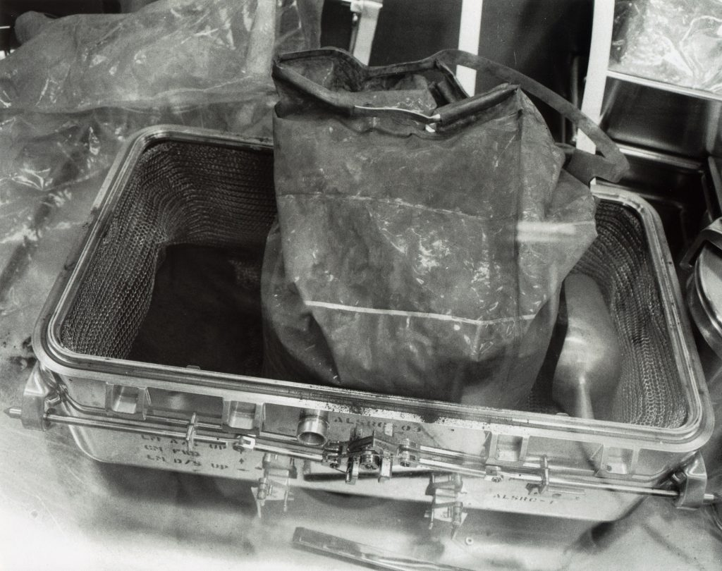 Lunar rock samples being unpacked at MSC on July 25, 1969.