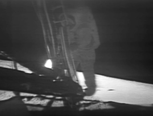 A live telecast of Neil Armstrong descending to the Moon's surface.