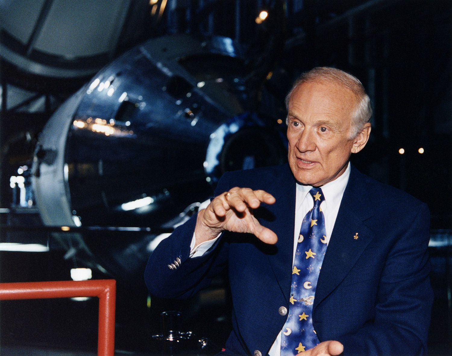 Buzz Aldrin speaking about his experiences at the Saturn V Center at Kennedy Space Center in during a celebration marking the 30th anniversary of the Apollo 11 mission. Credit: Tom Usciak