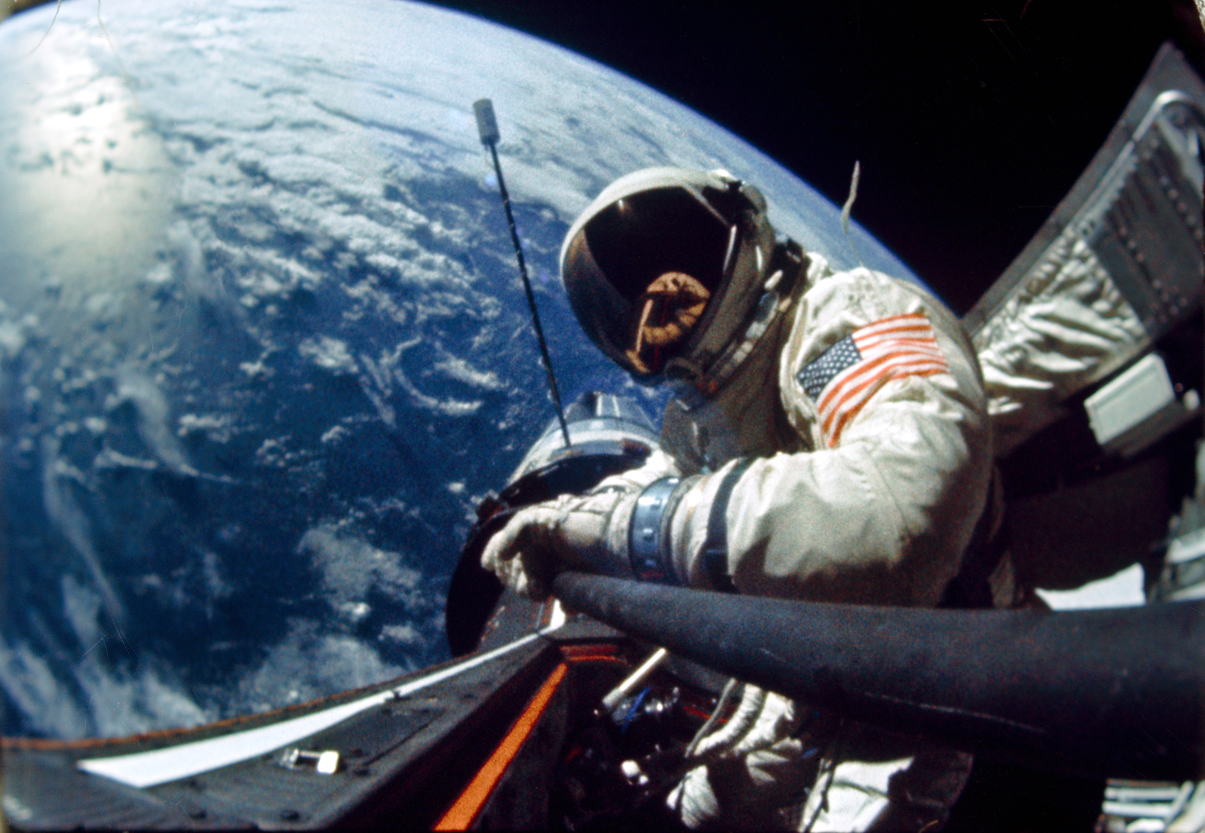 Buzz Aldrin performs an EVA during the Gemini XII mission. The Agena Target Vehicle is visible in the background. Credit: NASA