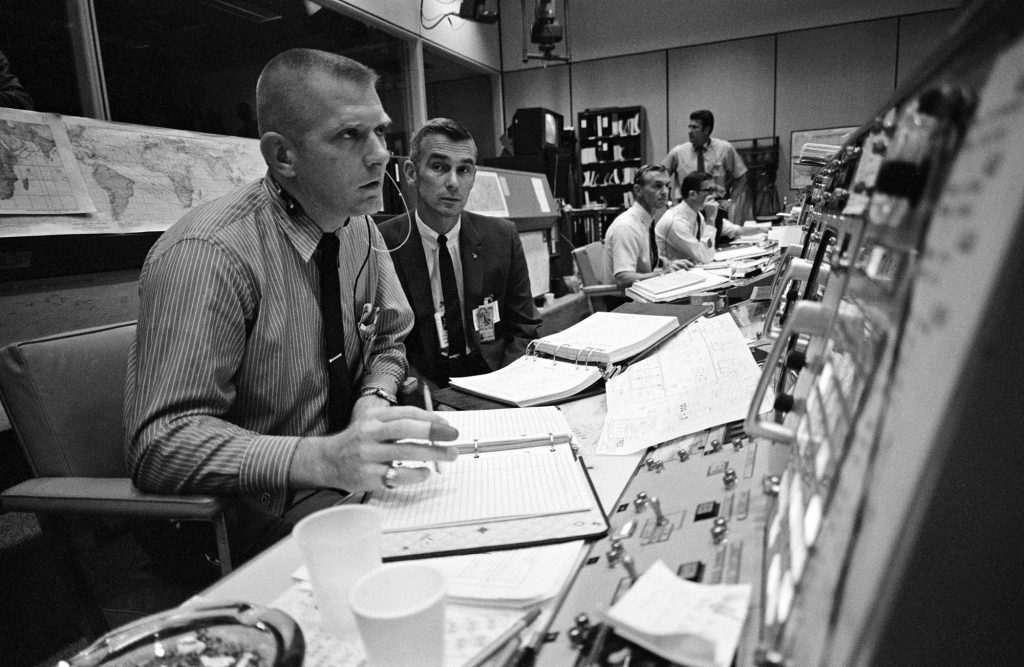Flight Director Gene Kranz (left) is joined in Mission Control by astronaut Eugene Cernan during the Apollo 11 mission.