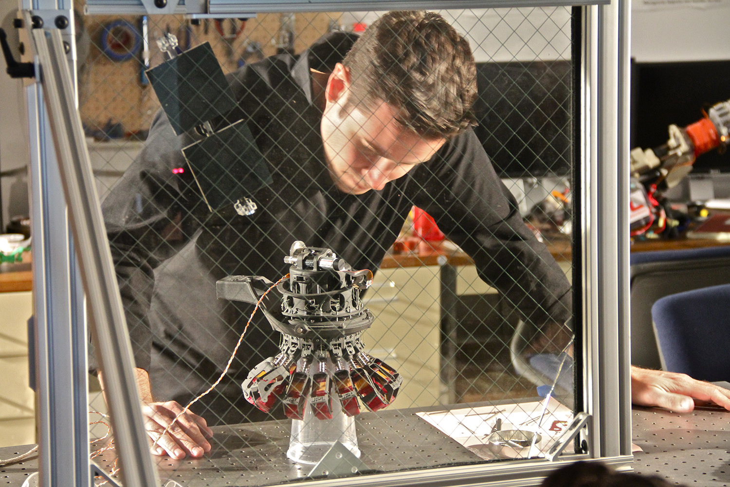 Jet Propulsion Laboratory – Group Leader, Aaron Parness working in his lab with a robotic microspine anchor 1. Credit: Rachael Joy/Science Channel