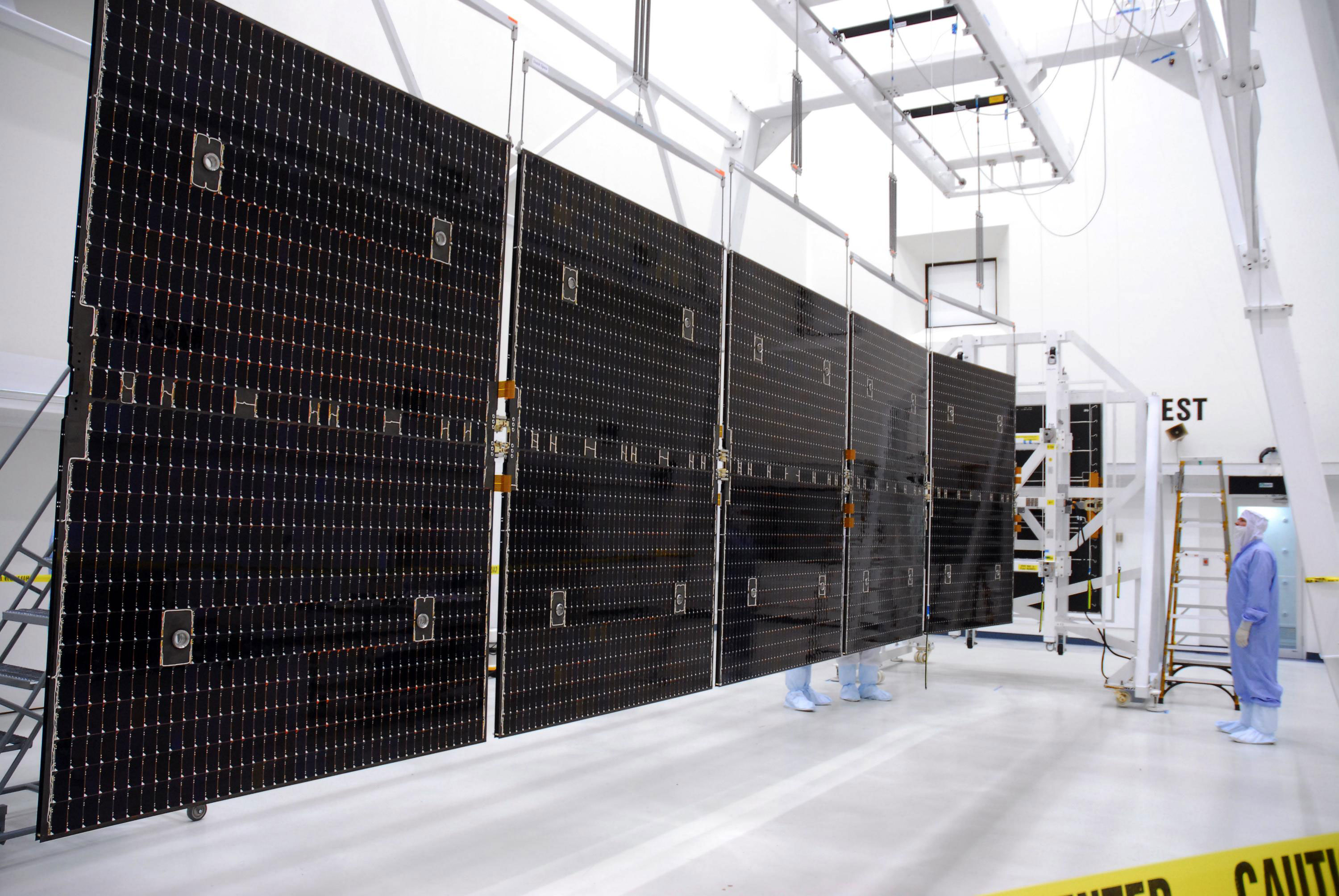 These are key in providing power for its ion propulsion system and for its instruments and on-board systems at a distance of almost 3 AU from the Sun. With its solar arrays fully extended, the spacecraft is 19.7 meters (65ft) long. The solar arrays have a total area of 36.4 square metres (392sqft). Credit: NASA/George Shelton