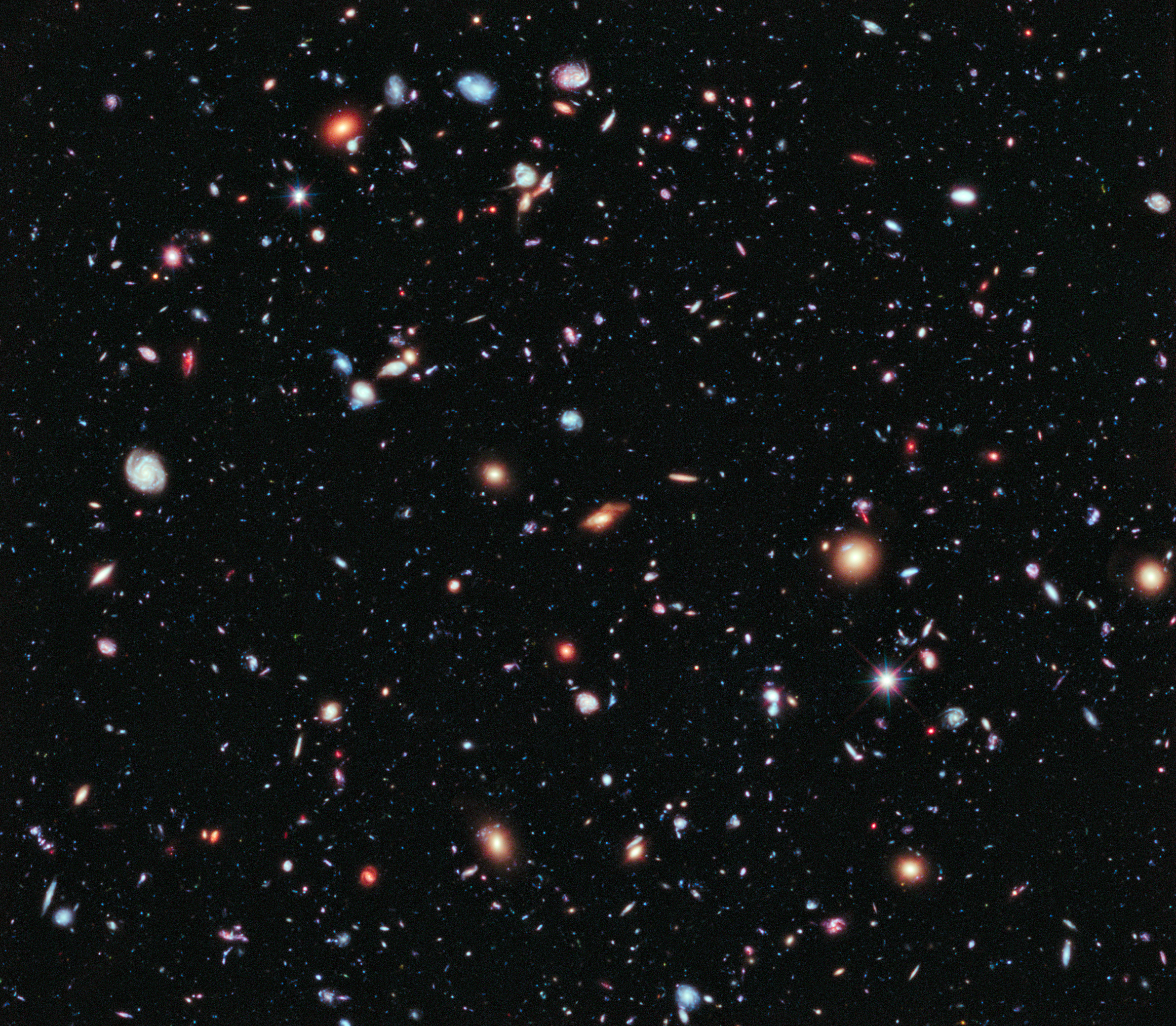 HUBBLE'S TOP 100 •#72 • Credit: NASA, ESA, G. Illingworth, D. Magee, and P. Oesch (University of California, Santa Cruz), R. Bouwens (Leiden University), and the HUDF09 Team