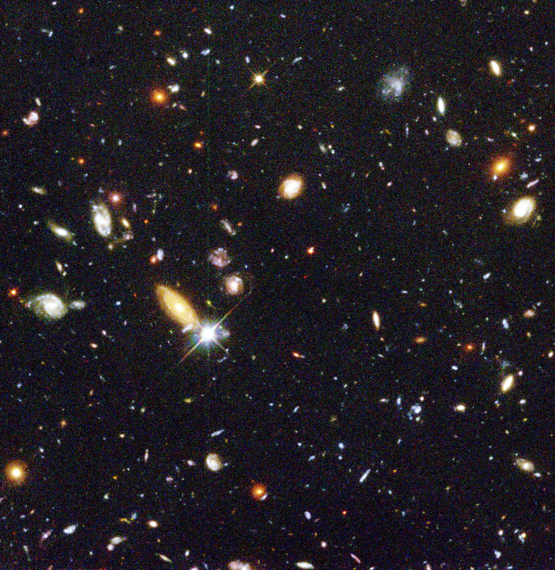"Representing a narrow ""keyhole"" view of the universe, the original Hubble Deep Field image covers a speck of the sky only about the width of a dime 75 feet away. Credit: Robert Williams, Hubble Deep Field Team (STScI), NASA"