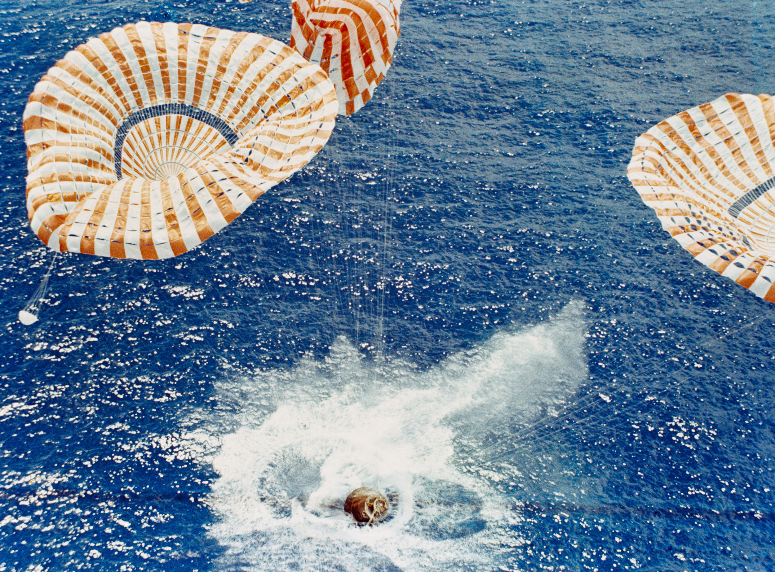 The Apollo 15 Command Module safely touches down in the mid-Pacific Ocean even though one of the three main parachutes failed to function properly. Credit: NASA