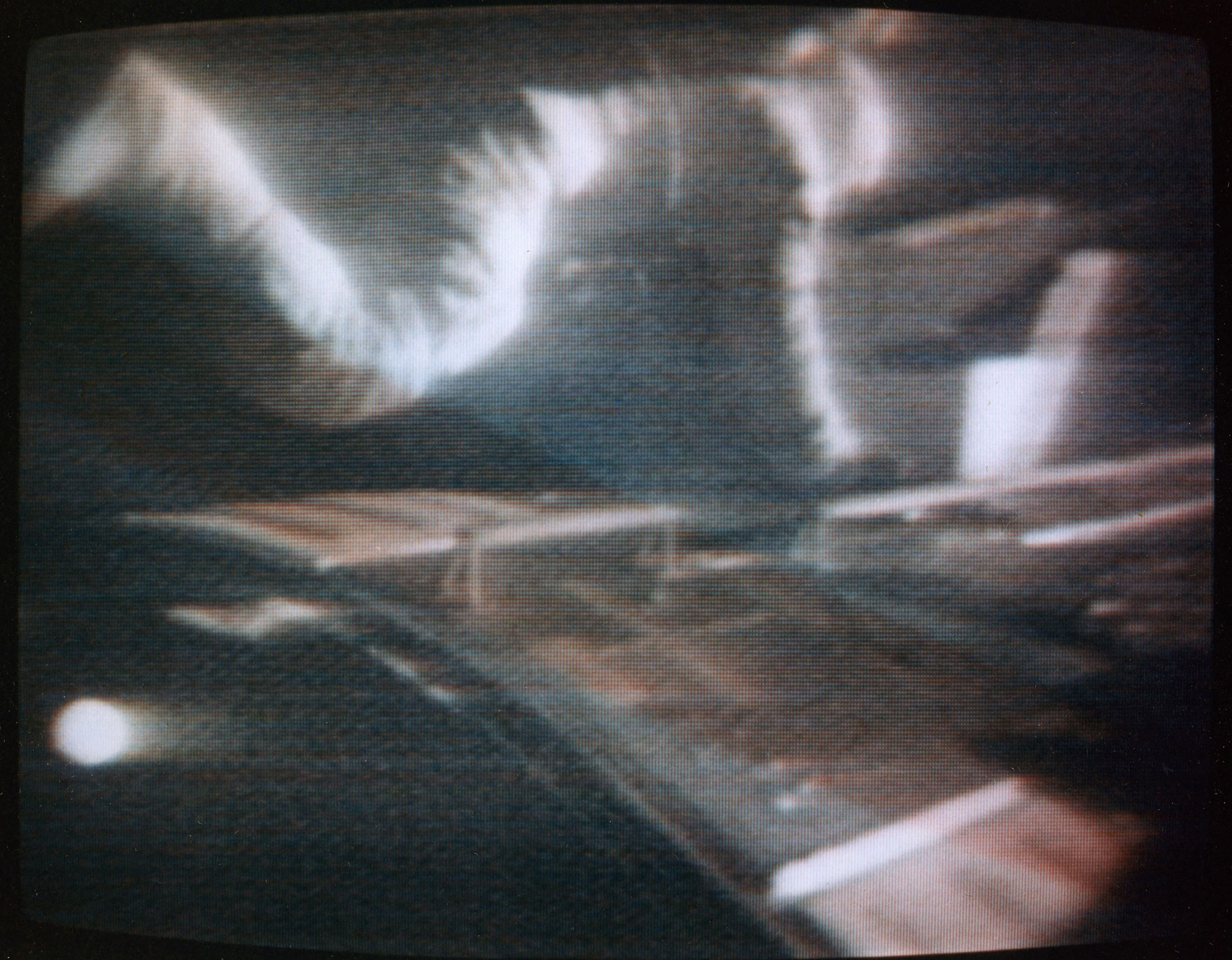 Still frame from a video of Worden during his EVA to retrieve film from cameras in the SIM bay of the Command Module. Credit: NASA via Retro Space Images