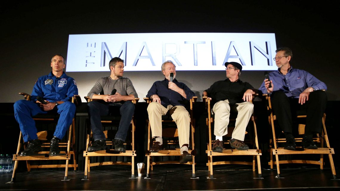 """NASA astronaut Drew Feustel, left, actor Matt Damon, film director Ridley Scott, author Andy Weir, and NASA Director of the Planetary Science,  Jim Green, participate in a question and answer session about NASA's journey to Mars and the film """"The Martian,"""" Tuesday, Aug. 18, 2015, at the United Artist Theater in La Cañada Flintridge, California. NASA scientists and engineers served as technical consultants on the film. The movie portrays a realistic view of the climate and topography of Mars, based on NASA data, and some of the challenges NASA faces as we prepare for human exploration of the Red Planet in the 2030s. Credit: NASA/Bill Ingalls"""