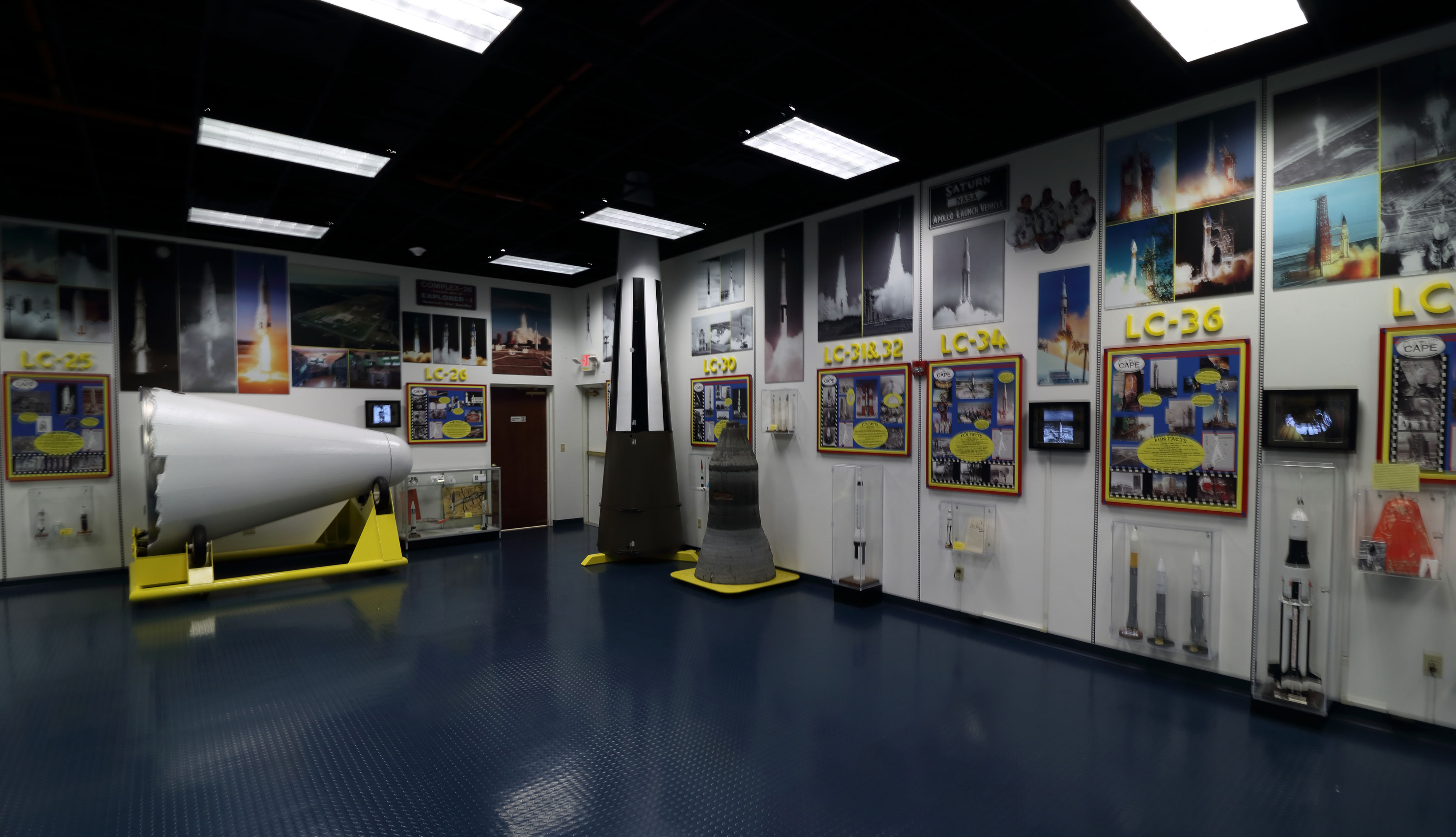 Among the artifacts on display at the Air Force Space and Missile History Center are an original Gemini console (top left), an Atlas sustainer rocket engine (top roght), and a Jupiter rocket nose cone (white cone in bottom photo). Credit: Lloyd Campbell