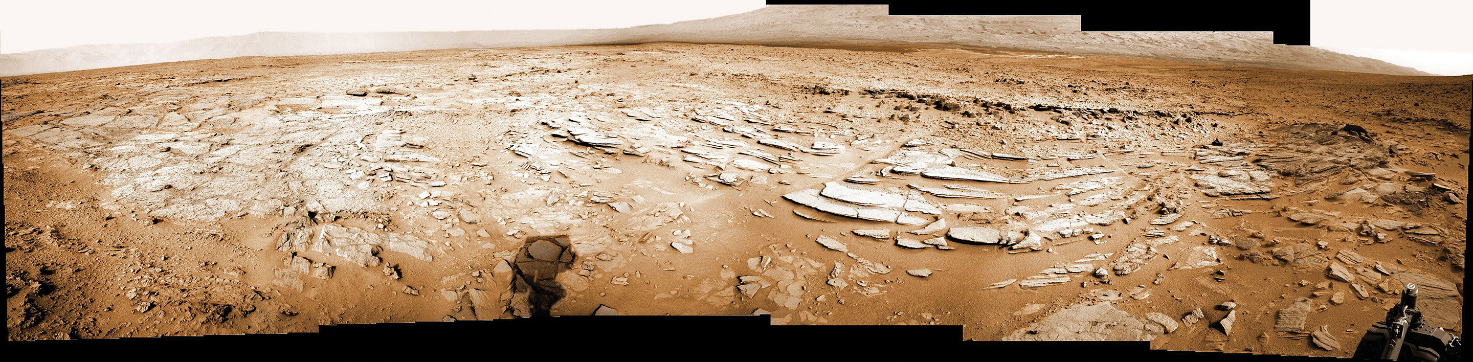 Sol 120 colorized panorama shows big Shaler layered rock outcrop snapped by Curiosity's right eye Navigation Camera (Navcam) on Dec. 7, 2012. Shaler exhibits a pattern known as 'crossbedding', at angles to one another. Mount Sharp visible in the background. Credit: NASA/JPL-Caltech/Ken Kremer/Marco Di Lorenzo