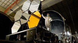 Ball Aerospace lead optical test engineer Dave Chaney inspects six primary mirror segments prior to cryogenic testing.  Photo: NASA/MSFC/David Higginbotham