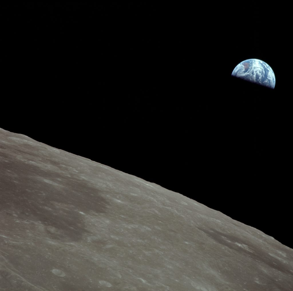 A half-eclipsed Earth as seen from the Moon's orbit during the Apollo 11 mission.