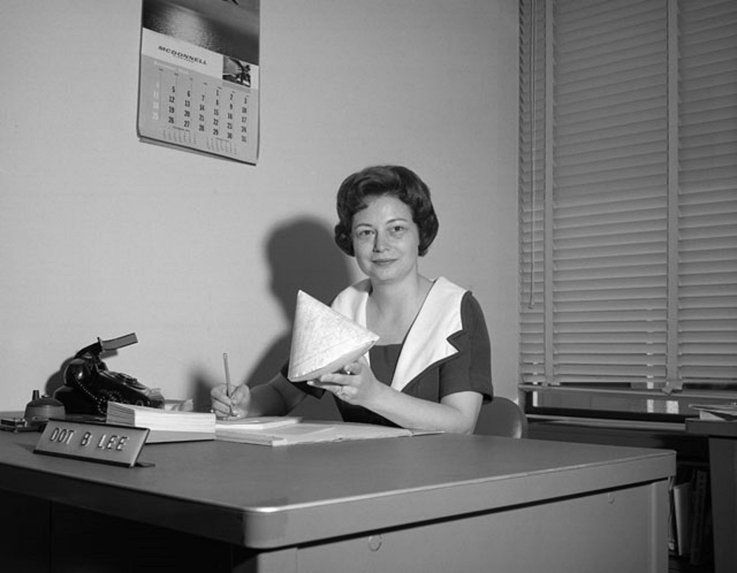 """Dorothy Lee, the """"human computer with a calculator"""" hard at work developing re-entry predictions for Apollo. Credit: NASA Johnson Space Center"""