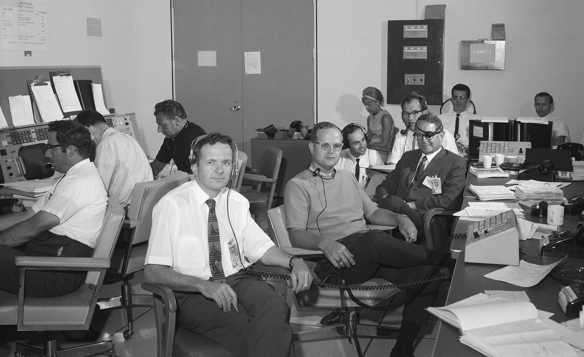 Tom Kelly (front) works in one of the 'back rooms' of Mission Control during the Apollo 11 mission. Credit: NASA via Retro Space Images