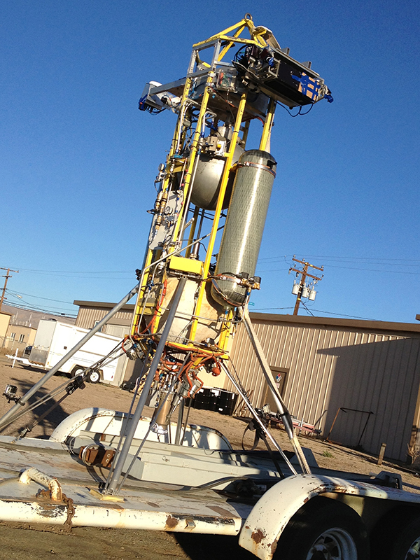 Mojave, CA -- Astrobotic Technology's autonomous landing system (computer on top of rocket) ready to be tested on a Masten Space Systems' XA-0.1B Xombie rocket 2.  Credit: Rachael Joy/Science Channel