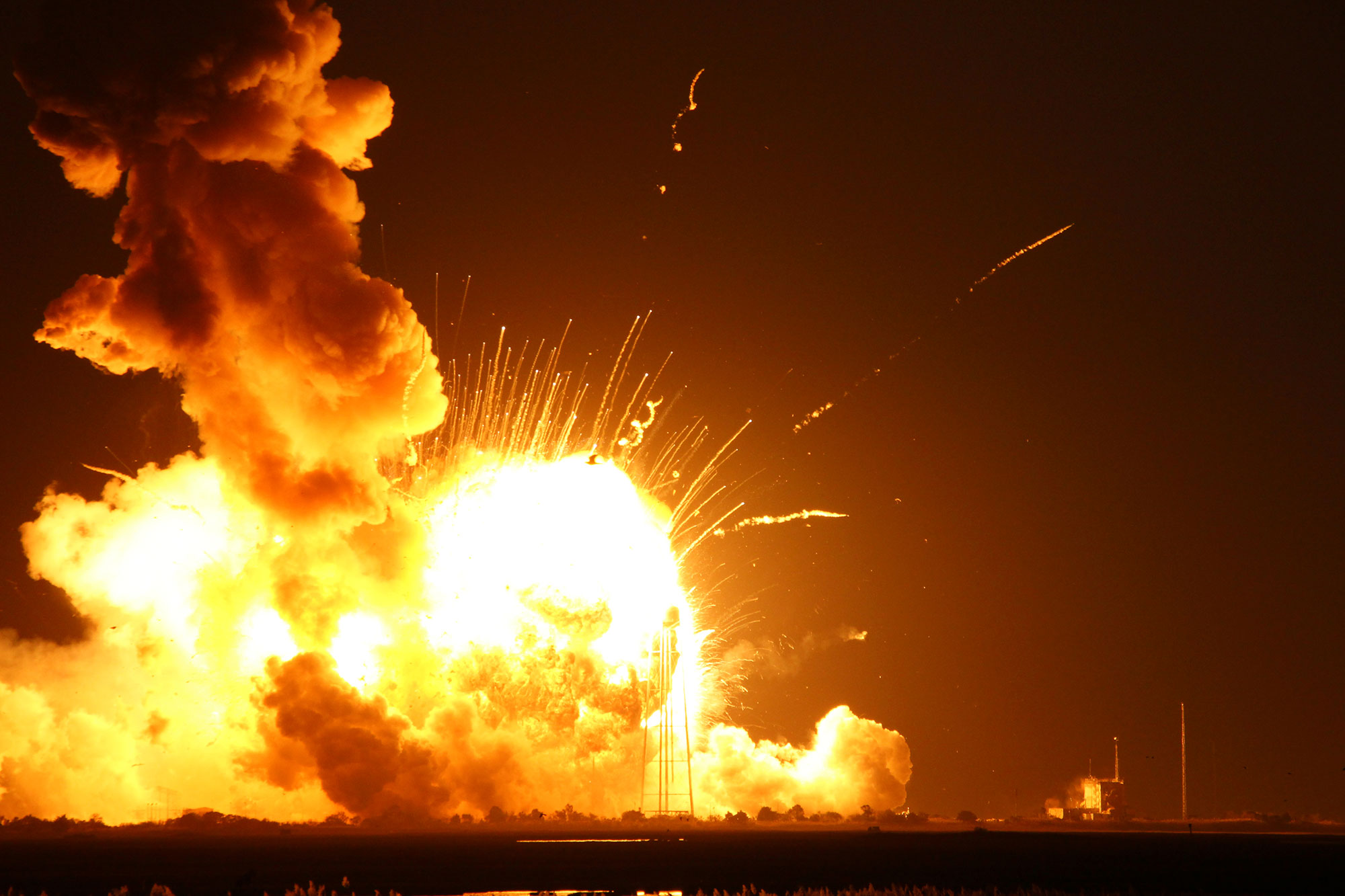 The aerial fireball that erupted from the Antares rocket seconds after blastoff could be seen for many miles. The pressure wave and heat wave from the explosion were even felt at the press site nearly two miles away from the launch pad. Credit: Ken Kremer
