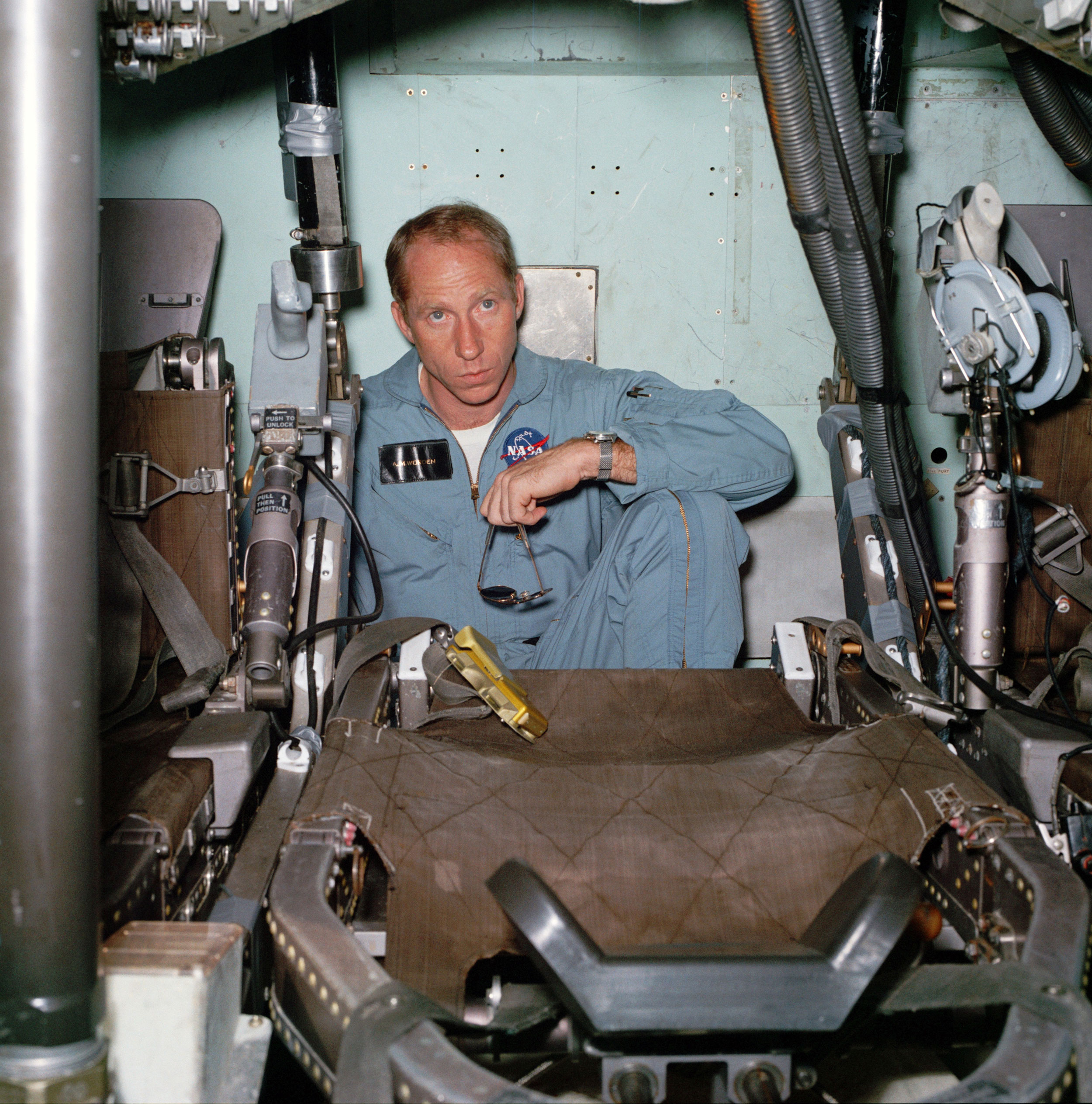 Worden sits alone inside the Command Module mockup during training before the Apollo 15 mission. Credit: NASA via Retro Space Images