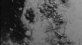 A newly discovered mountain range lies near the southwestern margin of Pluto's Tombaugh Regio (Tombaugh Region), situated between bright, icy plains and dark, heavily-cratered terrain. This image was acquired by New Horizons from a distance of 48,000 miles (77,000 kilometers) and received on Earth on July 20. Features as small as a half-mile (1 kilometer) across are visible. Credit: NASA/JHUAPL/SWRI