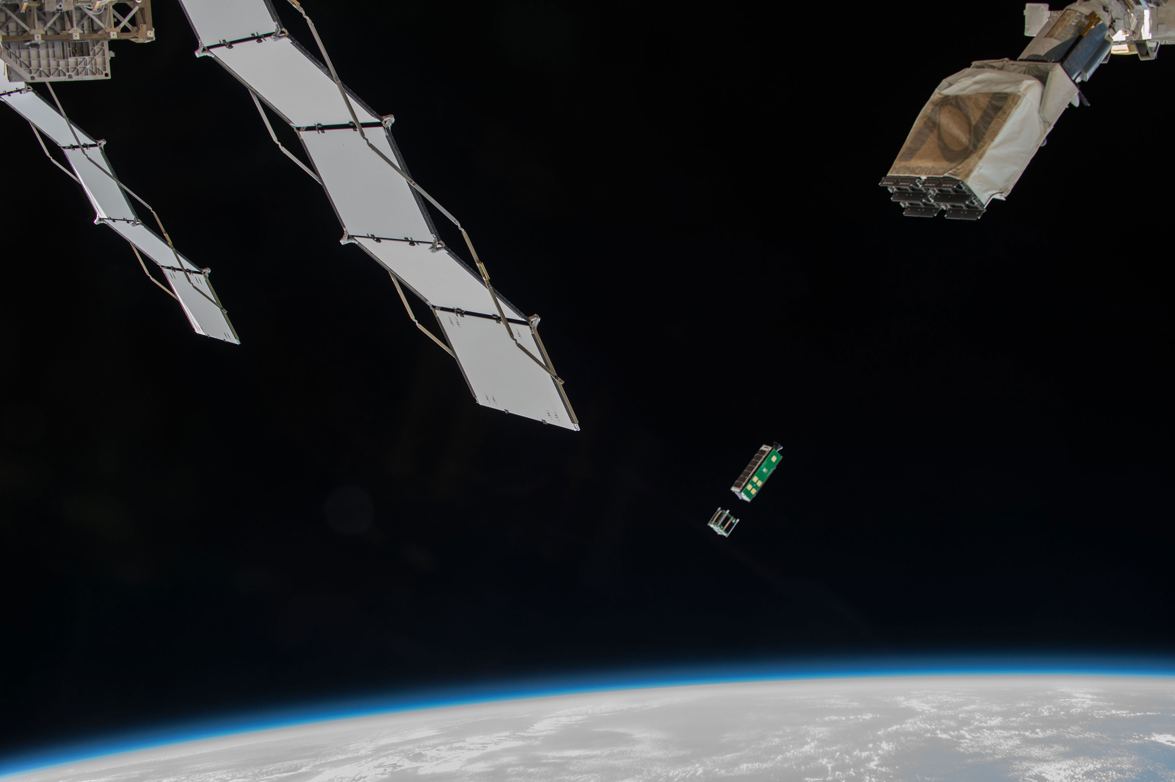 The Arkyd 3R shown being deployed from the ISS Kibo Airlock in July 2015. It successfully completed the objectives of testing core prospecting spacecraft technologies. Credit: NASA