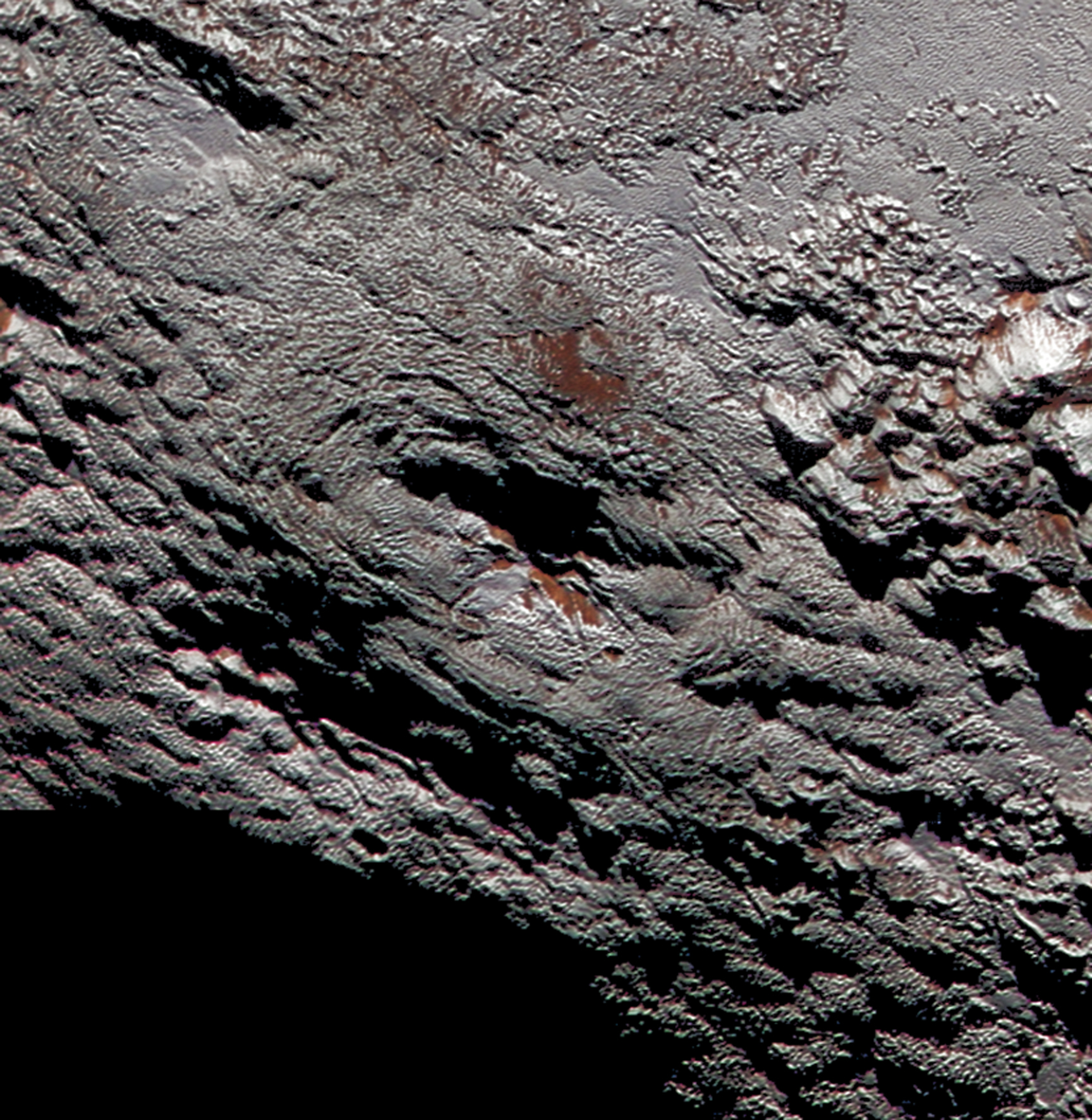 Figure 14: This rounded mountain, named Wright Mons, has what appears to be a summit crater. It is one of two candidates for evidence of possible recent cryovolcanism seen on Pluto by New Horizons. Credit: NASA/JHUAPL/SwRI