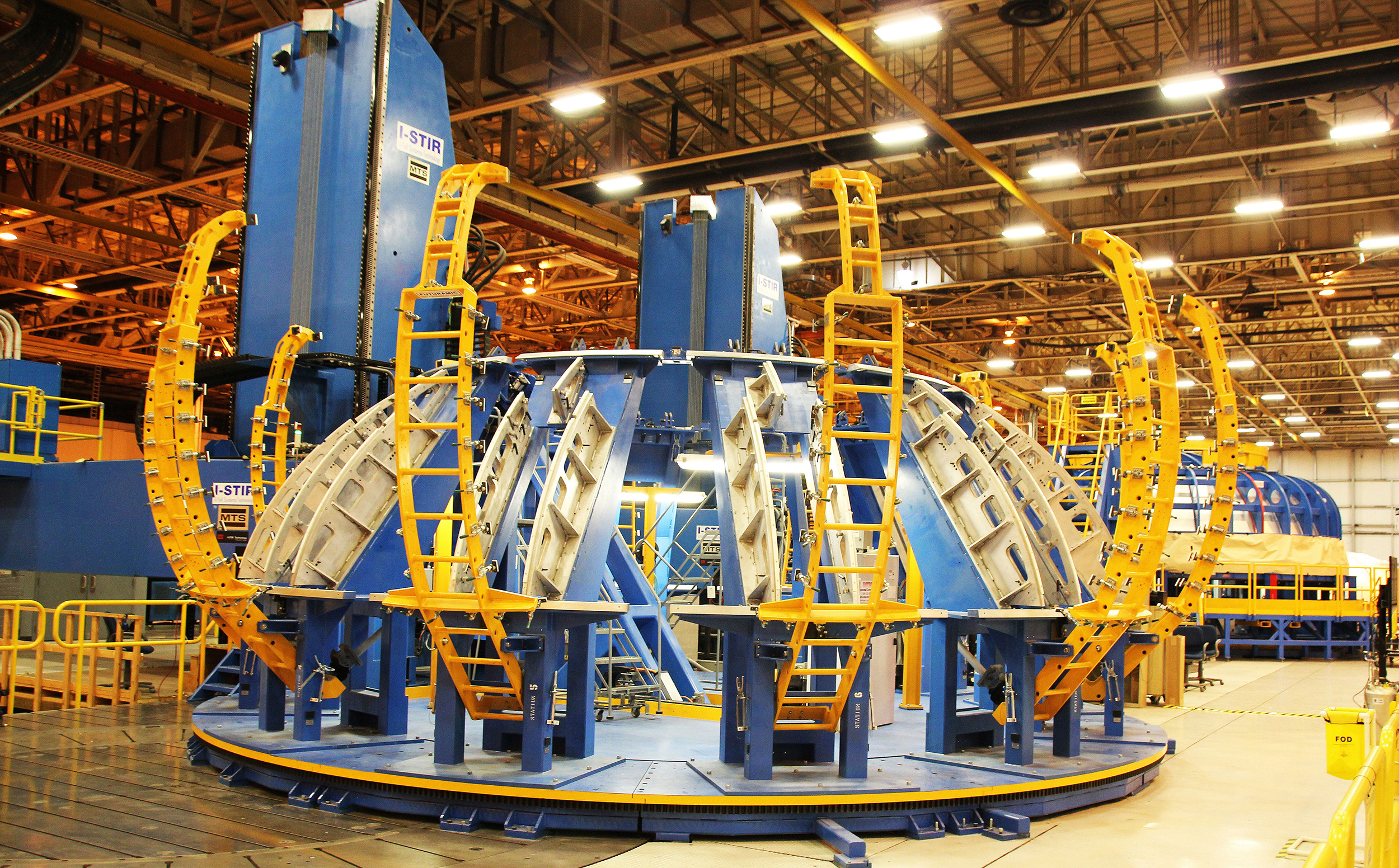 The Gore Weld Tool (foreground) and Circumferential Dome Weld Tool (background) used to fabricate dome segments for the SLS liquid hydrogen and oxygen core stage tanks via vertical friction stir welding operations at NASA's Michoud Assembly Facility in New Orleans. Credit: Ken Kremer